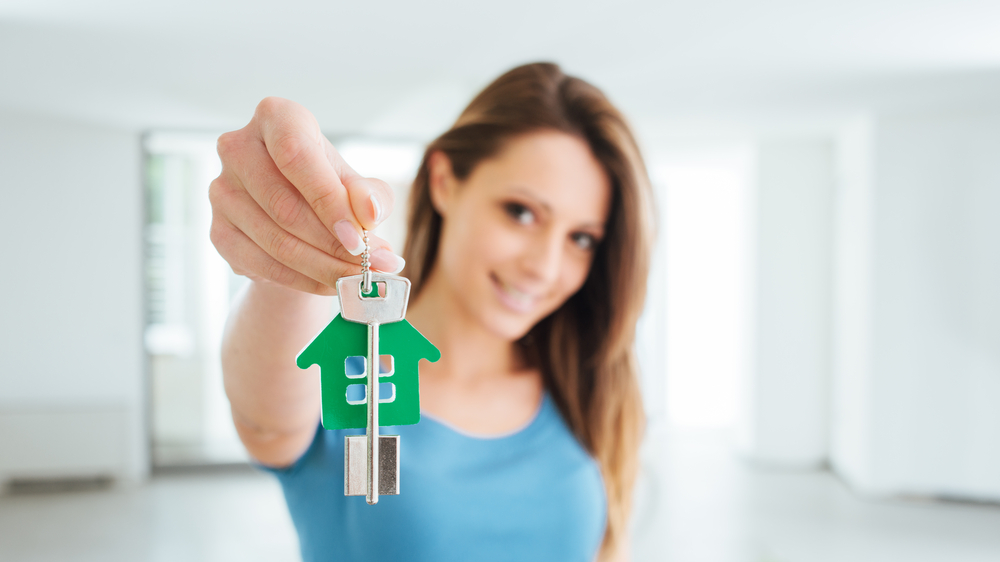 A tenant holds the keys to her new home